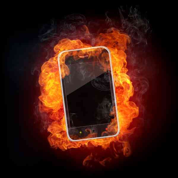 Smartphone in fire Isolated on Black Background.